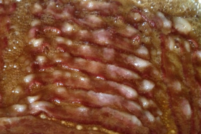 Sugar bacon at the midpoint of baking.